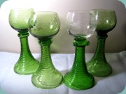 Wine rummers or goblets, 3 in green and                           one in green and clear glass