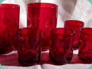 Red tumblers with                           dimples