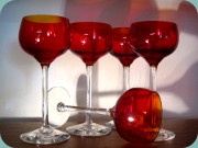 Wine goblets in red glass with clear                           stem
