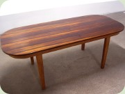 Rosewood veneer dining table with rounded corners