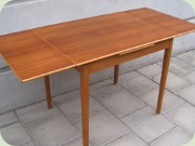 50's small teak & oak dining table                           with Dutch leaves