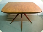 50s or 60s teak dining                           table with split pedestal base inthe manor of                           gio ponti