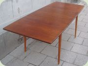 60's teak dining table with extension leaves.