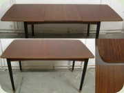 Swedish 60's teak dining table with 2 leaves and black legs with brass ends