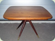 50's teak dining table with split pedestal base in the manor of Gio Ponti