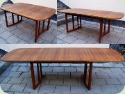 Rectangular teak dining table with two leaves