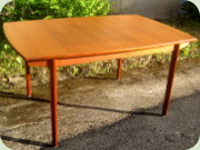 Scandinavian 60's teak                           dining table with 2 extension leaves