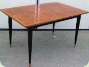 Swedish 50's teak                           veneered dining table with black lacquered                           legs