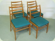 Set of four 50's or                           60's beech dining chairs
