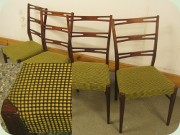 Mahogany coloured dining chairs with greenish yellow upholstery