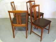Set of four teak dining chairs with dark brown vinyl upholstery