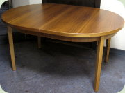 Swedish 60's oval                           walnut dining table with extension leaf folded                           under the table top