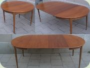 60's round walnut dining table with extension leaves.