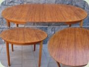 Swdish 50's or 60's teak veneered round dining table with 2 leaves
