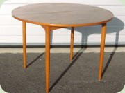 50's teak neat round                           dining table with one leaf