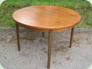 Swedish 60's round                           walnut dining table with leaf