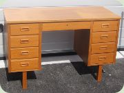 60's Swedish teak desk with four drawers on each side and one in the middle