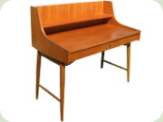 Scandinavian 60's teak writing desk with                           3 drawers, tapered legs and shelf