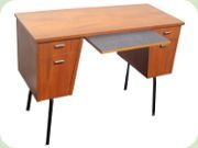 Teak desk with black lacquered aluminum legs and leaf in Perstorp's laminate
