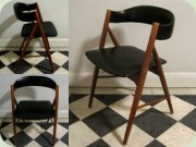 Scandinavian 50's teak side chair with tapered legs upholstered in black vinyl
