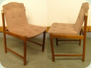 Set of four teak or                           walnut stained chairs