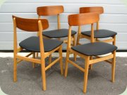 Set of four Scandinavian 60's teak & beech dining chairs upholstered in black vinyl