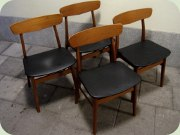 Set of four Danish 60's teak & beech dining chairs upholstered in black vinyl