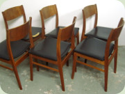 A set of 6 Scandinavian 60's teak and oak                           black vinyl upholstered dining chairs