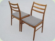 Four teak/teak stained beech dining chairs