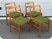 Set or four Swedish 50's or 60's teak stained birch dining chairs with green fabric upholstery
