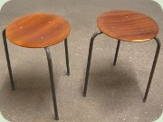 Three legged teak stools with black lacquered legs