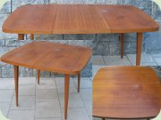 Swedish 50's or 60's teak veneer square dining table with rounded corners and one extension leaf