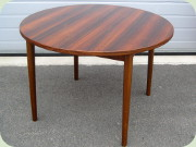 Swedish 60's Nils                           Jonsson Troeds Malta round rosewood dining                           table with 2 leaves stored folded under the                           table top